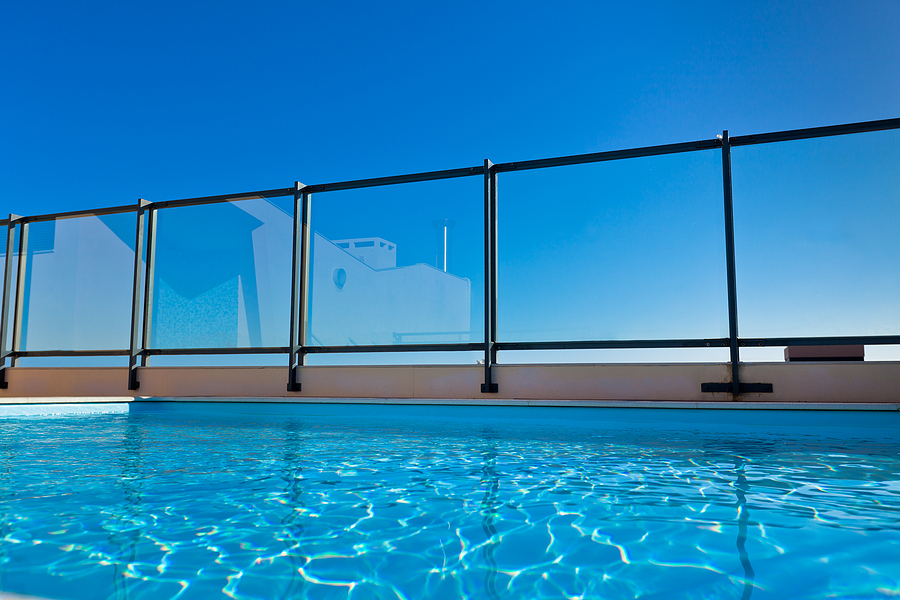 Apartment house with outdoor swimming pool at the roof. Horizontal shot